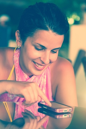 Happy Woman Smiling and Texting on a Mobile photo