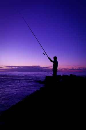 Fisherman at Sunset in Tenerife, Canary Island, Spain Stock Photo