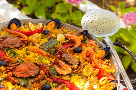 Prepared Spanish Paella with Crabs and Shrimps photo