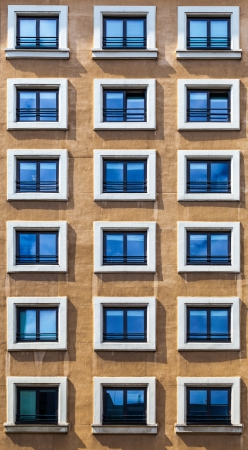 Window Pattern on a Brown Facade in Madrid photo