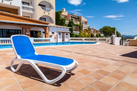 stoneware: Deck Chair in a Swimming Pool from a Rural Village in Mallorca, Spain Stock Photo