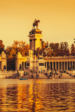 rowboats: MADRID, SPAIN - NOVEMBER 9: People relaxing in rowboats in the scenic pond of Buen Retiro Park besides the Alfonso XII Monument in a sunny day, on November 9, 2013 in Madrid, Spain Editorial