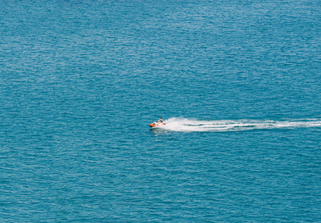 watercraft: Person Cruising the Mediterranean Sea over a Watercraft