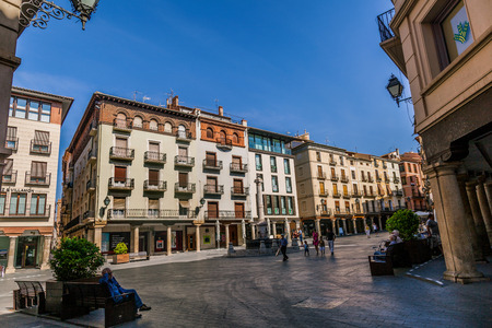 origins: TERUEL, SPAIN - AUGUST 24: Plaza del Torico is the nerve center of Teruel from its medieval origins. Its most emblematic point is the Torico a small sculpture of 1858, elevated on a high pedestal, on Teruel in August 24, 2014