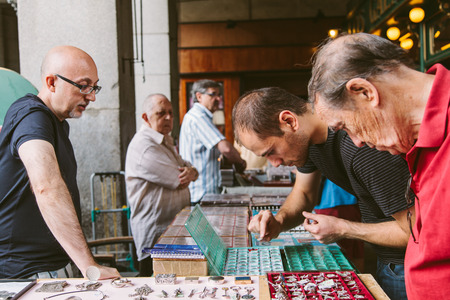 MADRID, SPAIN - SEPTEMBER 7: People at the Collectible Market of Stamps and Coins in Plaza Mayor, one of the most traditional Madrid classics on September 7, 2012 in Madrid.