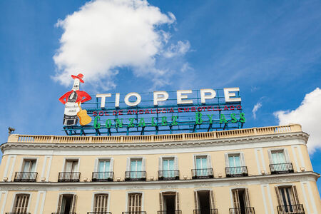 to pepe: MADRID, SPAIN- SEPTEMBER 7: The Iconic Tio Pepe sign (1935) of Gonzalez Byass Winery in its new emplacement in La Puerta del Sol square on September 7, 2014 in Madrid, Spain