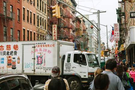 enclave: NEW YORK CITY - JUNE 16: Chinatown with an estimated population of 100,000 people is a neighborhood in Manhattan that is home to the largest enclave of Chinese people in the Western Hemisphere, on June 16, 2015 in Manhattan, New York