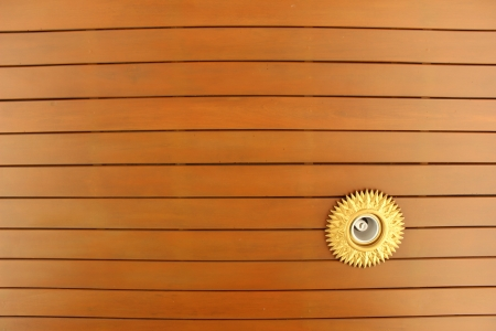 Natural color wooden ceiling with lighting at Thai Church Stock Photo
