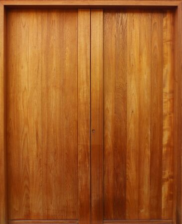 Teak wooden door with natural color Stock Photo