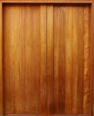 Teak wooden door with natural color Stock Photo