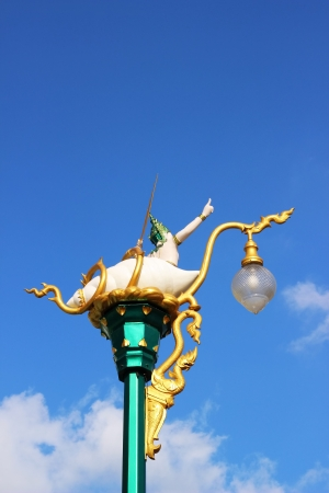 Thai lighting post with angel statue