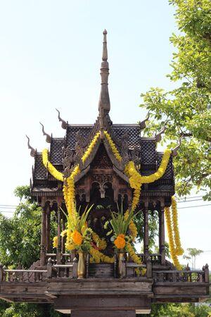 Thai wooden spirit house Stock Photo