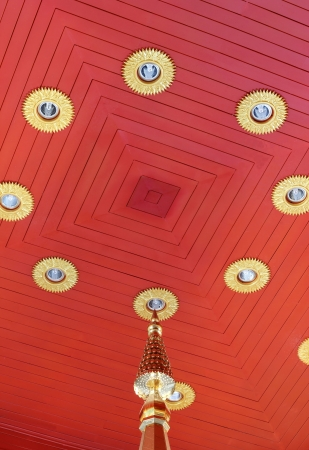 Thai wooden ceiling in pagoda with lighting fixtures