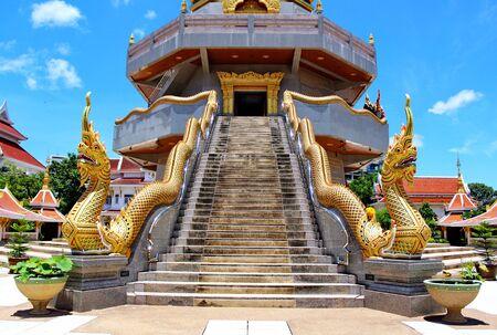 Naka statue on staircase balustrade of Thai pagoda