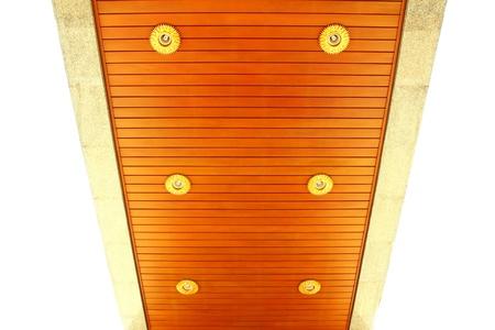 External wooden ceiling with lighting fixturesat Thai pagoda