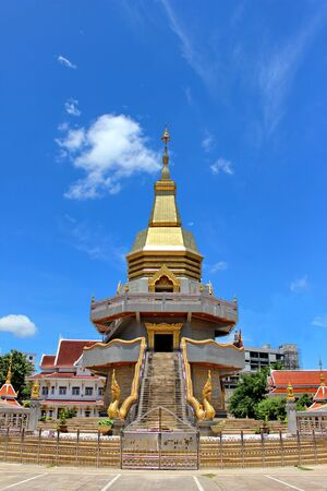 Thai Buddhist pagoda with blue sky background