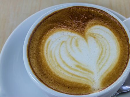 Cappuccino coffee with heart drawing closed up view