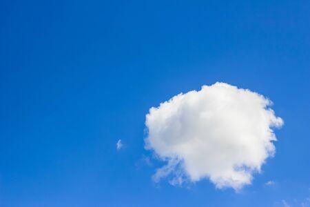 float cotton cloud: White cotton cloud in blue sky background