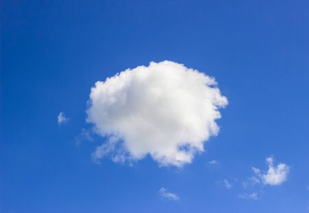 White cotton cloud in middle of blue sky background