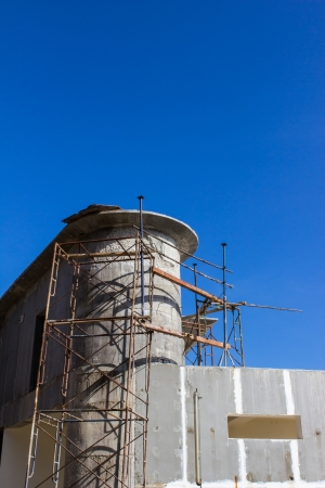 crook: Poor construction structure with blue sky background Stock Photo