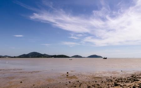crap: Low tide beach at late morning, Sapaanhin, Phuket, Thailand