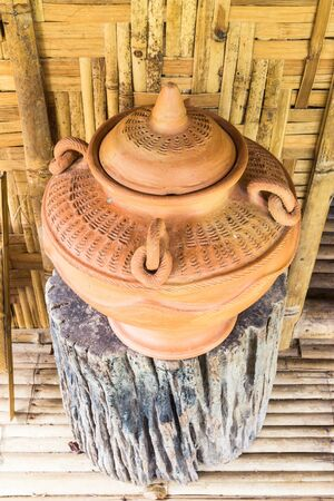 Thai style - antique clay drinking water jar for guest at bamboo cottage photo