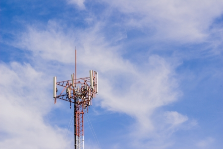 Mobile or cell phone tower with cloudy sky background Stock Photo