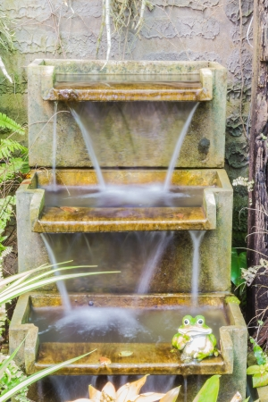 Artificial waterfall in botanic garden photo