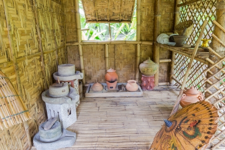 Thai style, antique kitchen with a lot of earthenware at bamboo cottage photo
