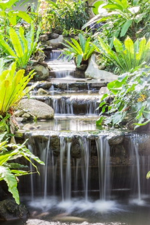 Artificial waterfall in butterfly garden, Thailand Stock Photo
