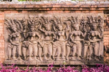 Sculpture of Apsaras on wall in garden, Thailand Stock Photo