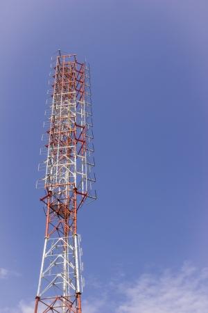 Radio or TV broadcast tower against blue sky background Banco de Imagens