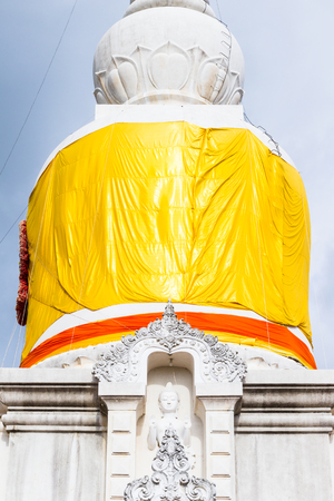 sacred source: Middle part of Thai pagoda called  Nadun pagoda  surrounding by yellow robe