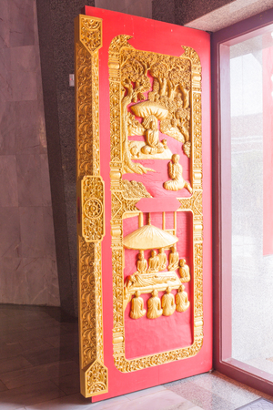 thailand s landmarks: The wooden door of Northeast Thai pagoda, Thailand