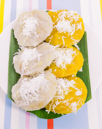 Thai dessert called Kanom thuay in white and yellow color (Coconut milk custard in small porcelain cup) photo