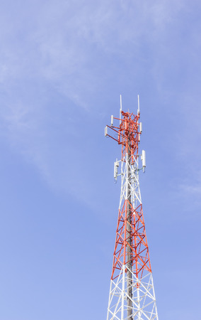 unsightly: Mobile phone tower against blue sky background