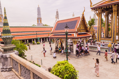 Bangkok, Thailand - June 5, 2016 : A lot of tourists at the Emerald Buddha temple or Wat Pra Kaew. It is well-known destination for all tourists to Thailand
