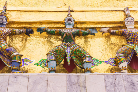 the emerald city: Demon Guardian at the Emerald Buddha temple or Wat Phra Kaew , Bangkok, Thailand. It is landmark and well-known destination for most tourists Stock Photo