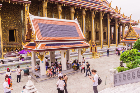 pra: Bangkok, Thailand - June 5, 2016 : A lot of tourists at the Emerald Buddha temple or Wat Pra Kaew. It is well-known destination for all tourists to Thailand
