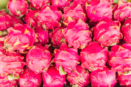 Dragon fruits selling at local Thai market, Northeast of Thailand Stock Photo