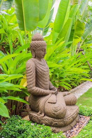 Stone Buddha Statue (indonesian Style) In Garden, Thailand Stock Photo    62998643