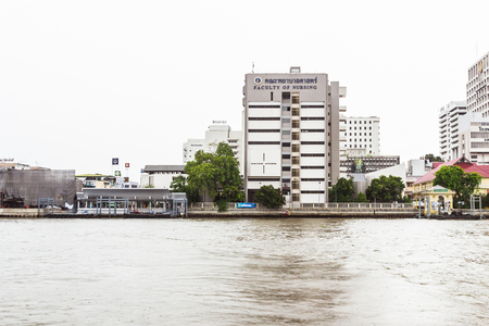 faculty: Bangkok, Thailand - June 5, 2016: The faculty of Nursing, Mahidol university view from the other side of Chao Phraya River on cloudy day Editorial
