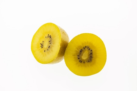 freshest: Kiwi slices into half on white background