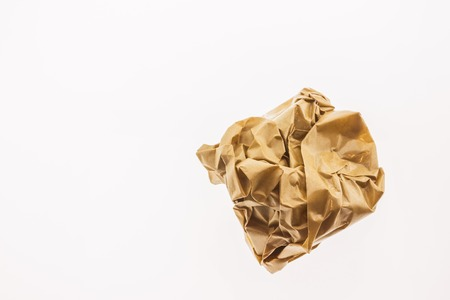 ball lump: Crumpled brown paper isolated on white background