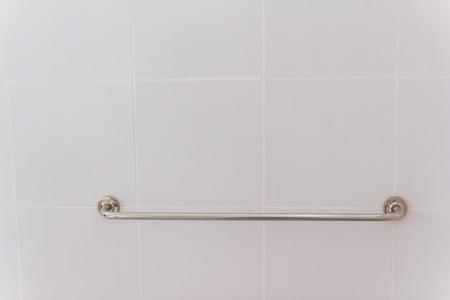 bathroom wall: Towel hanger on cream color bathroom wall