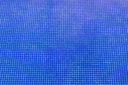 Blue tiles of swimming pool can be used as background