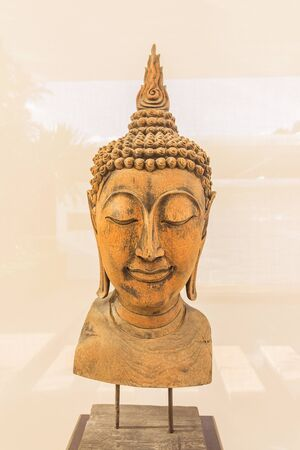 Wooden Buddha statue for decoration indoor Stock Photo