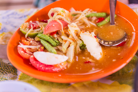 Thai Northeast food called Papaya salad. It is spicy and wellknown menu for all over the world