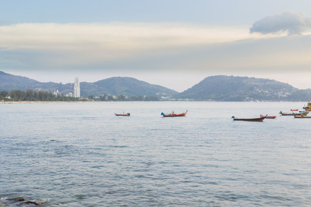 Patong beach on twilight cloudy, Phuket, Thailand. It is well-known destination for tourists all over the world. Stock Photo