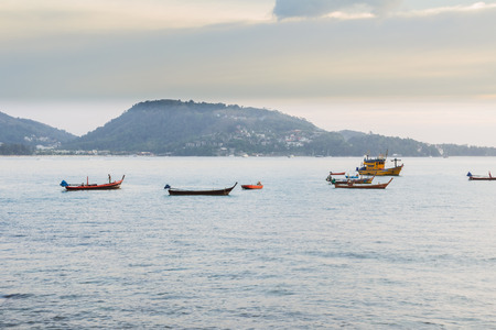 Patong beach on twilight cloudy, Phuket, Thailand. It is well-known destination for tourists all over the world. Editorial